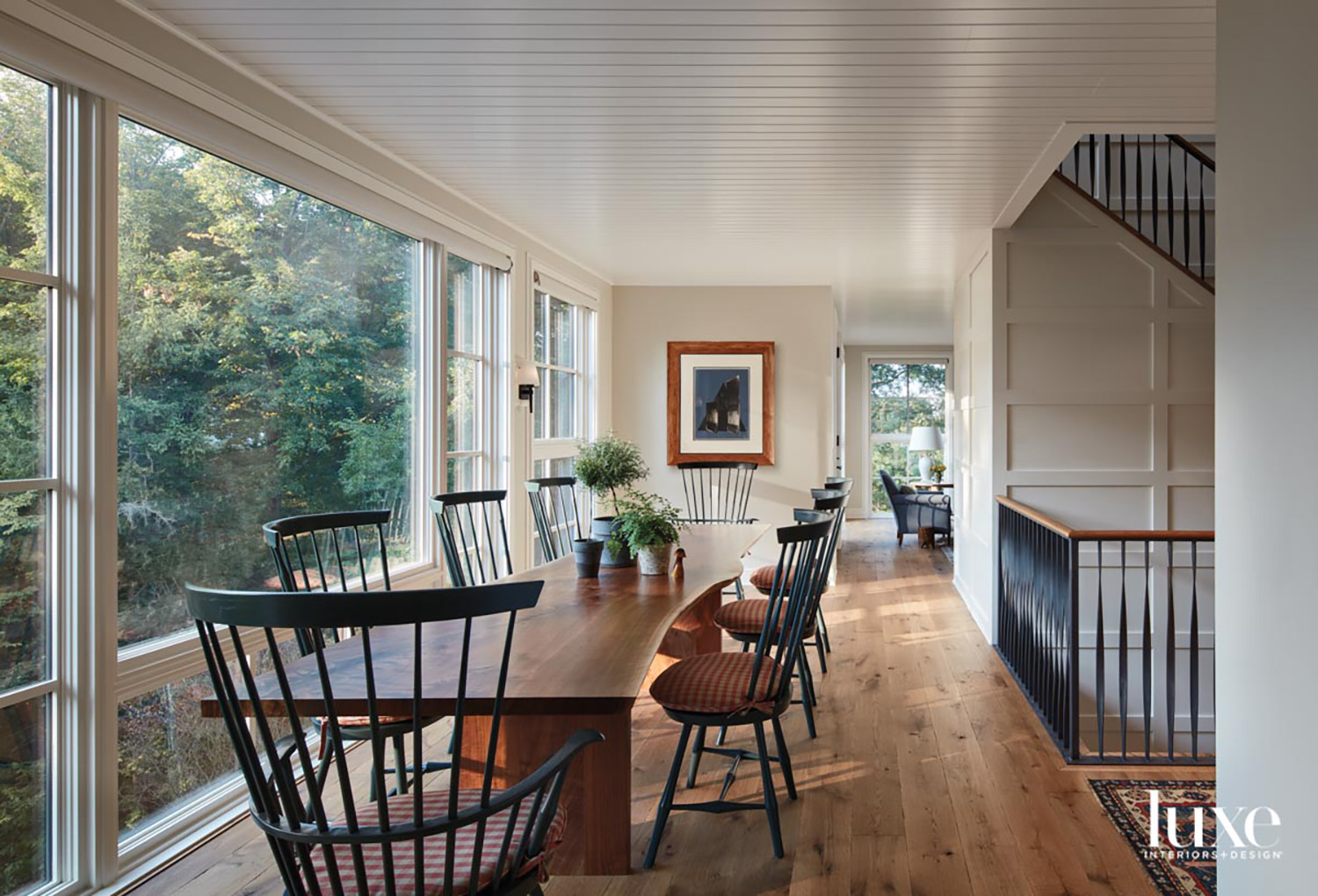 A dining room with floor-to-ceiling...