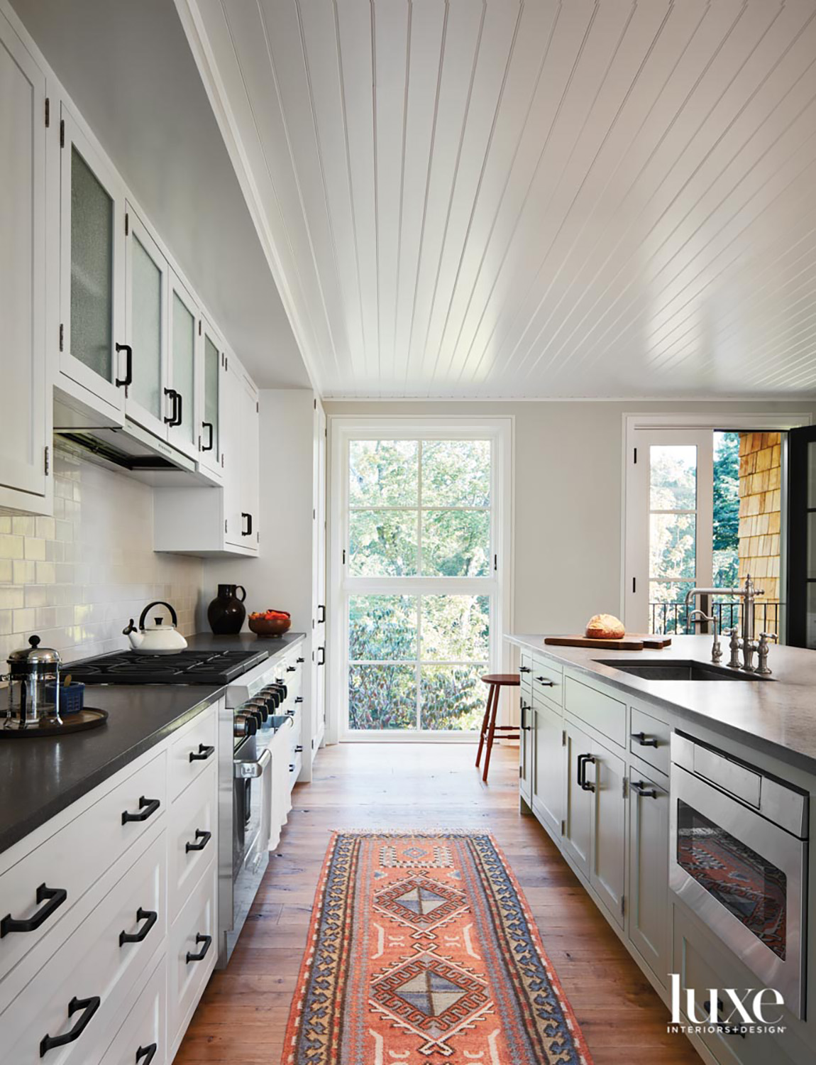 A kitchen with white cabinetry...