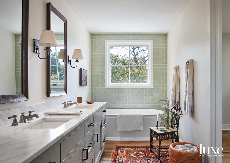 A standalone bathtub sits in...