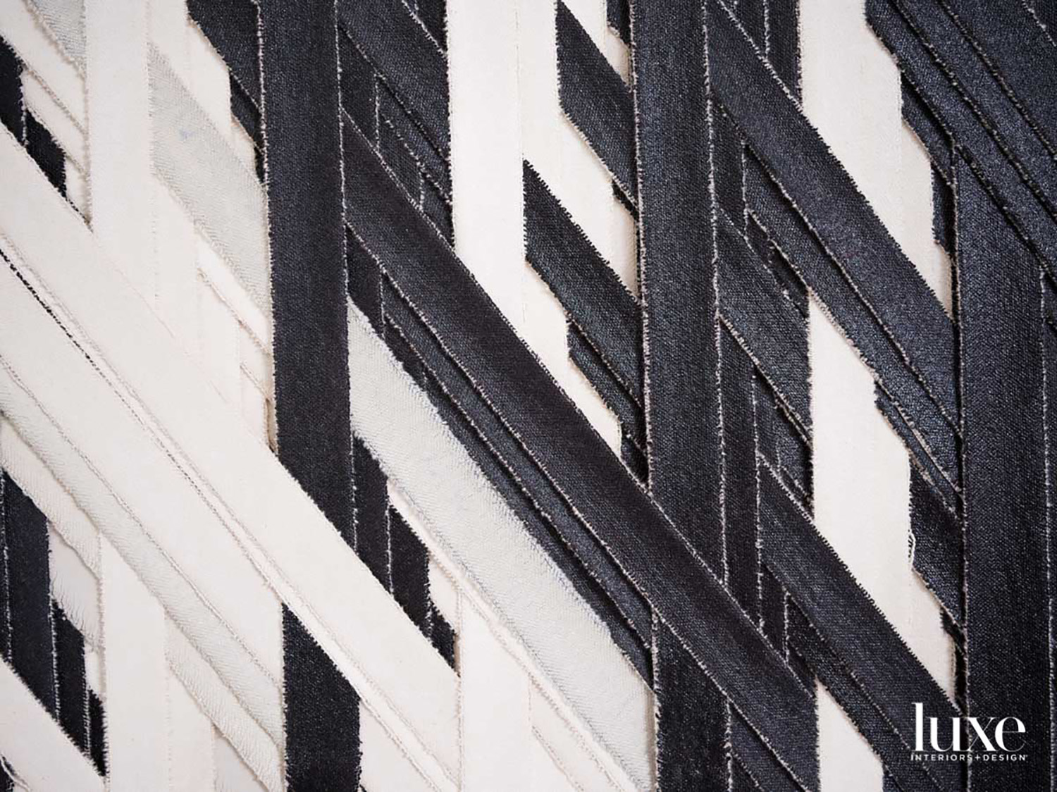 Black-and-white canvas strips woven together.