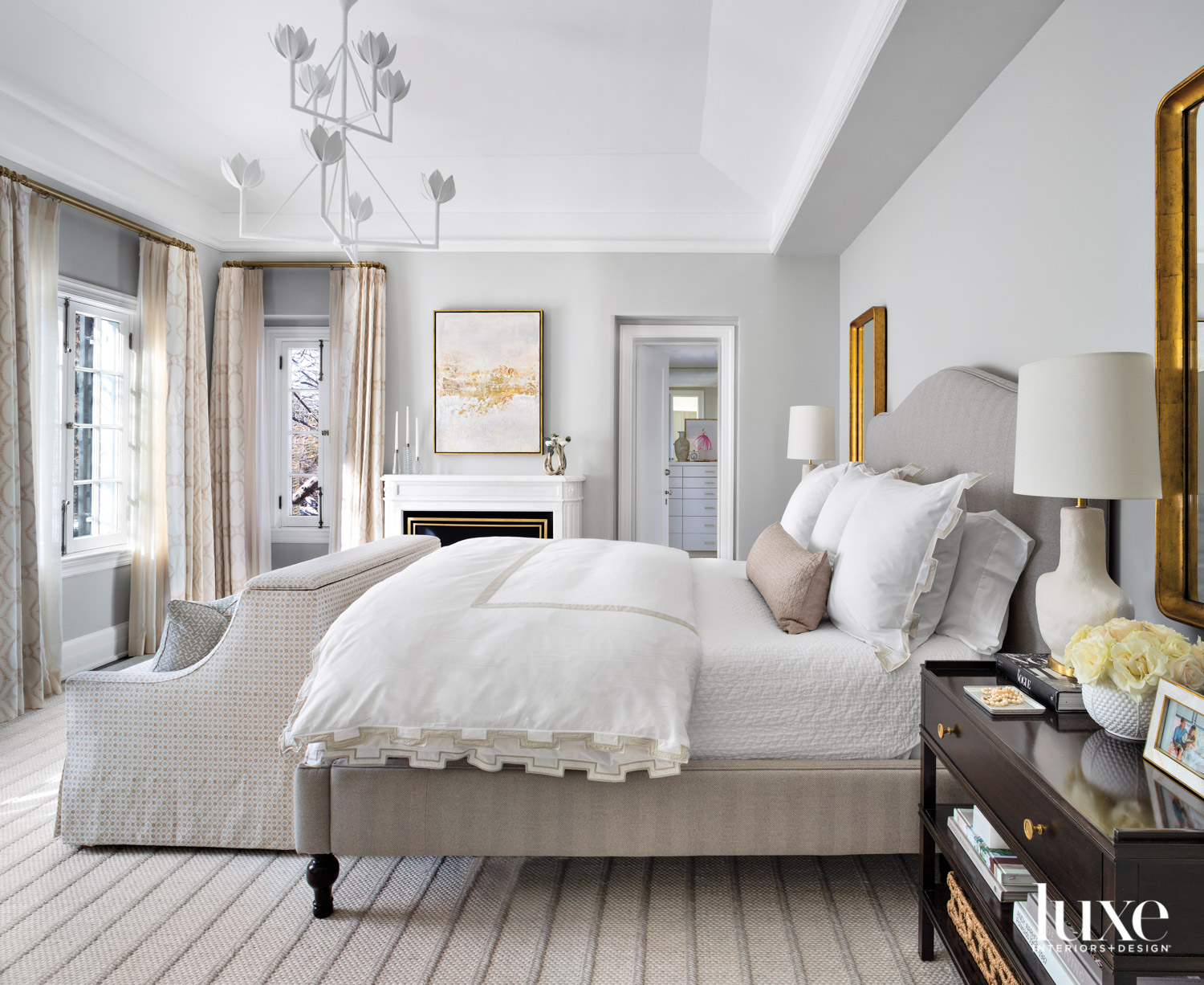 neutral main bedroom with white...