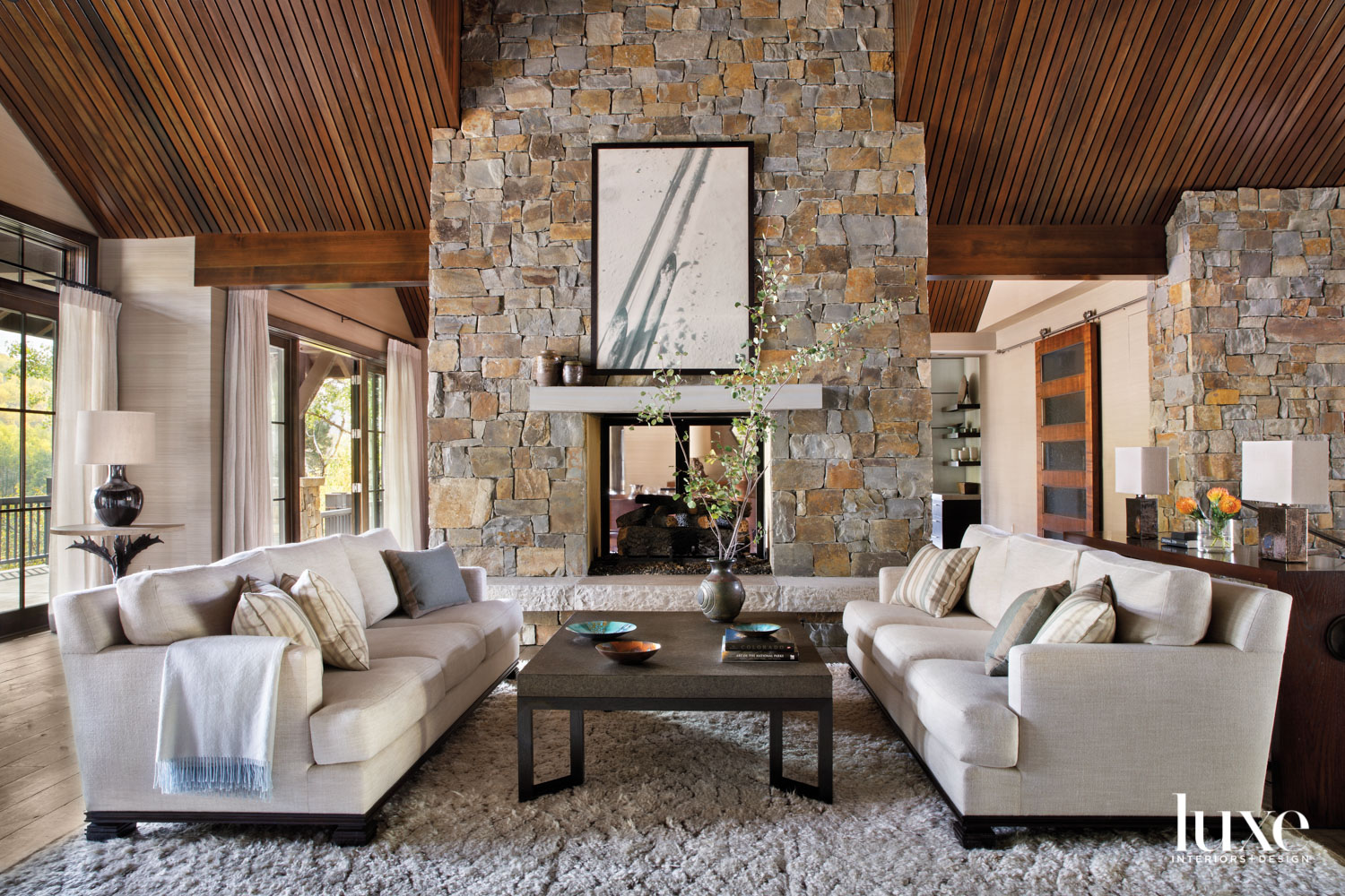 A large fireplace is the...