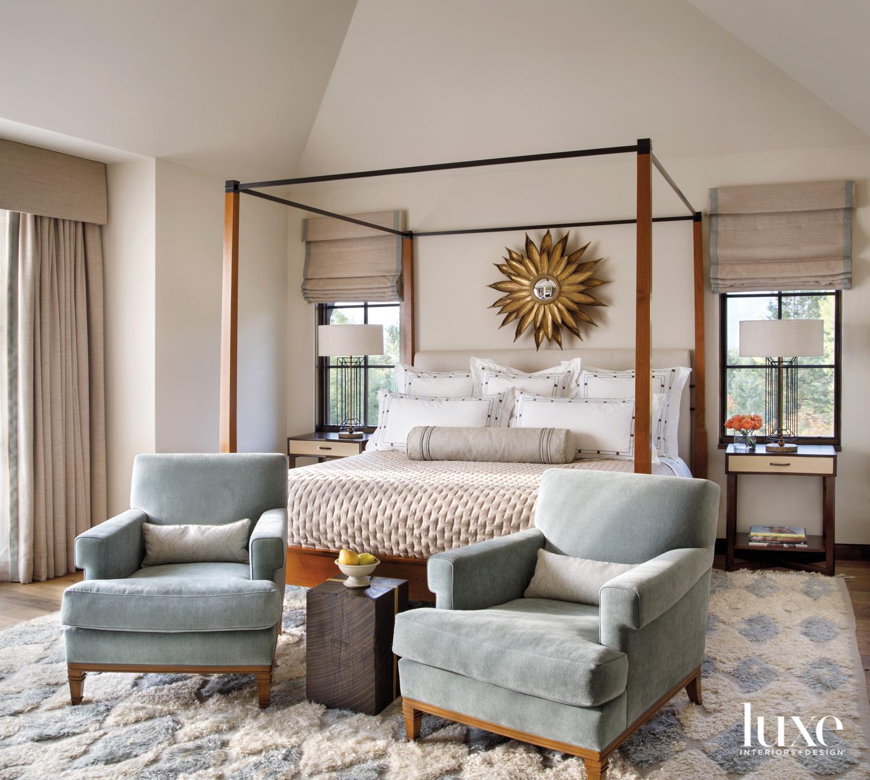 A guest bedroom has a...