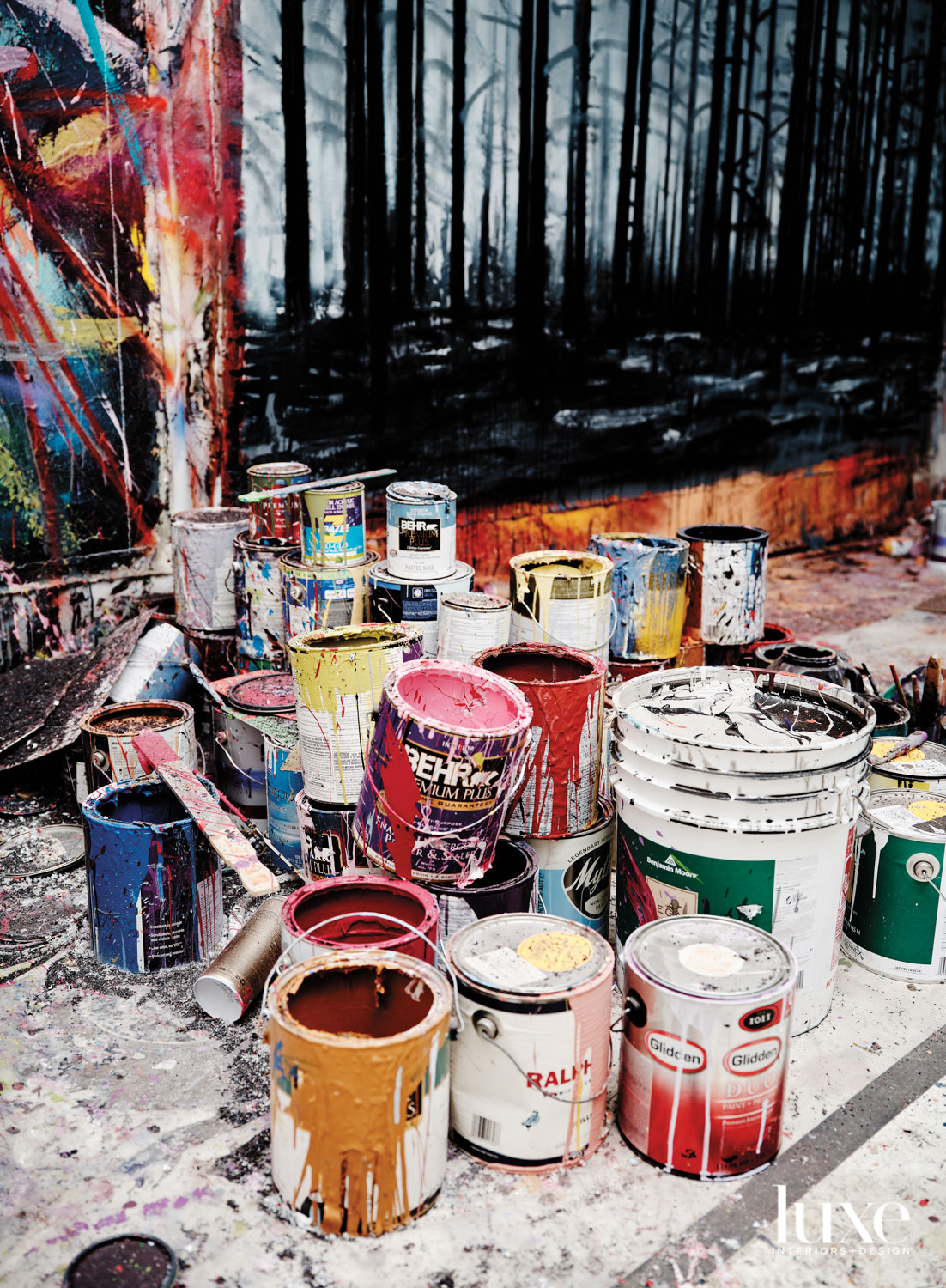 A group of paint cans in the artist's studio.