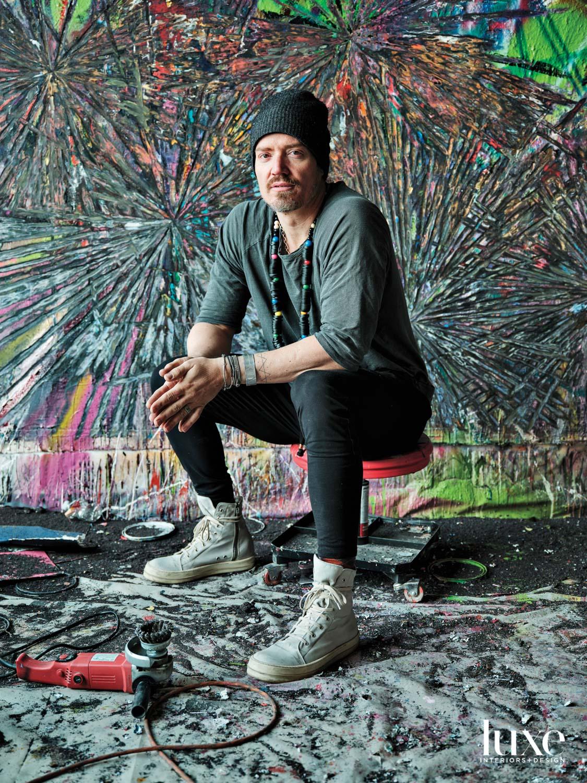 Andrew Jensdotter sits in his studio.