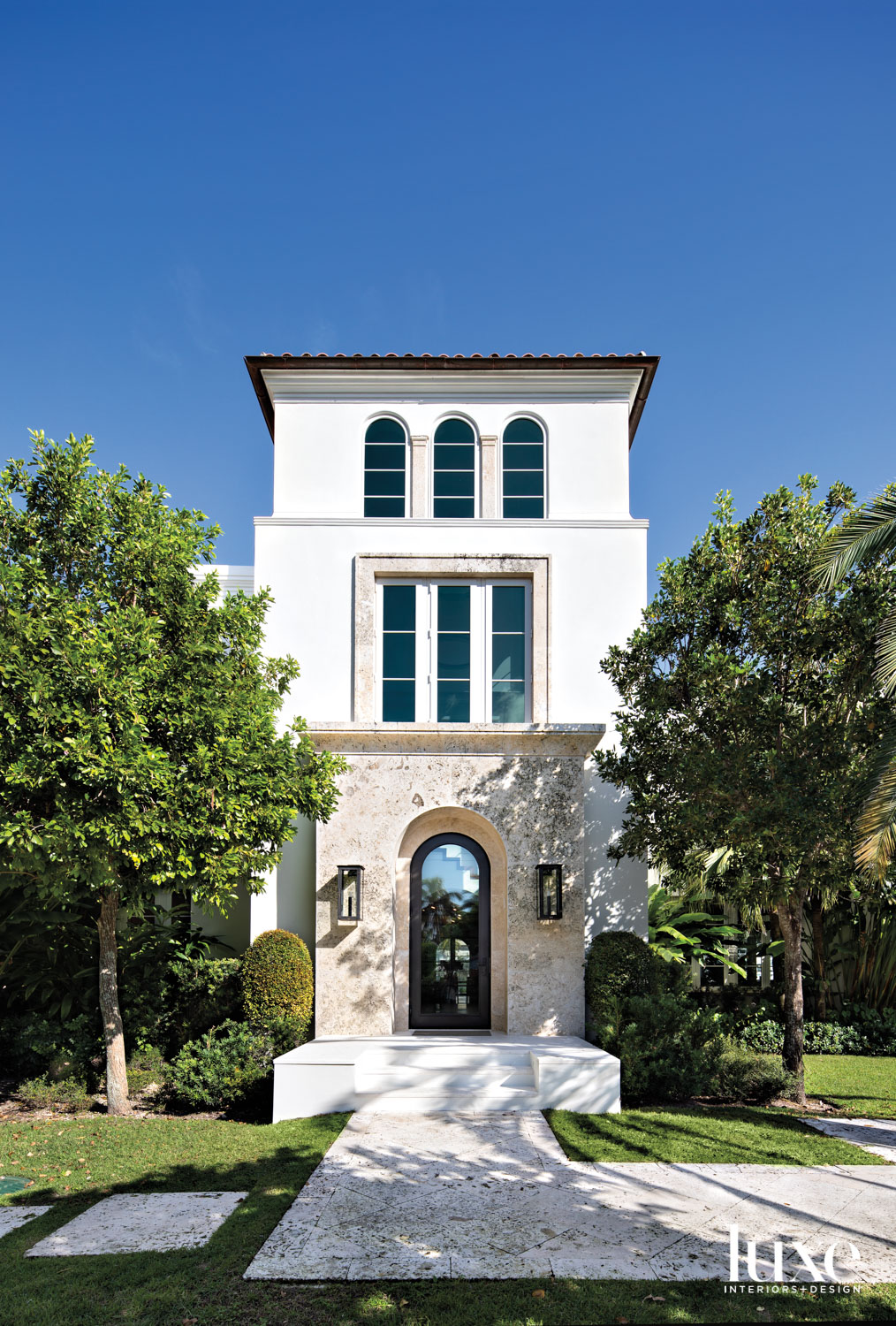 front exterior entry of mediterranean-style...