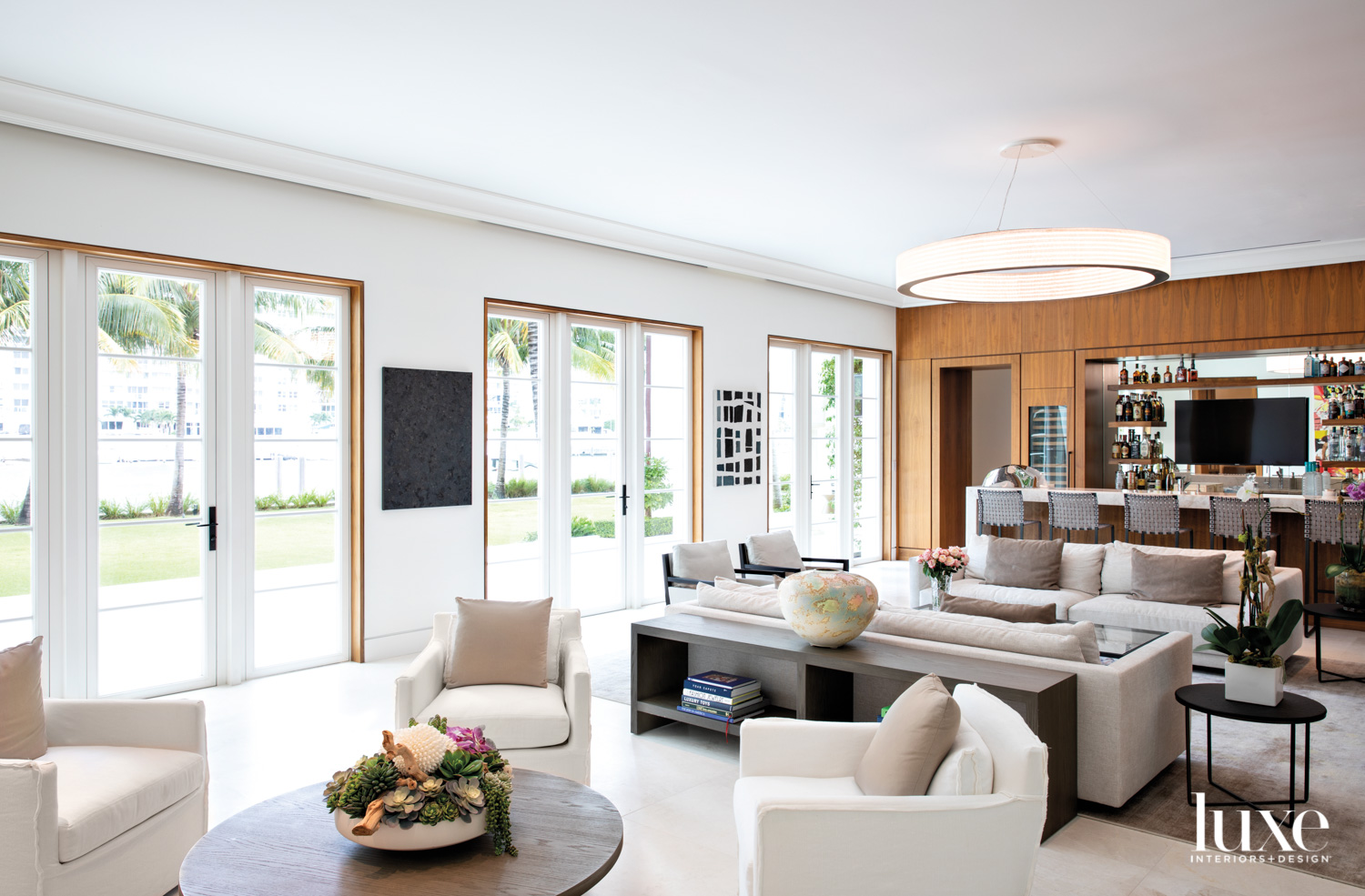 living area with white sofas,...