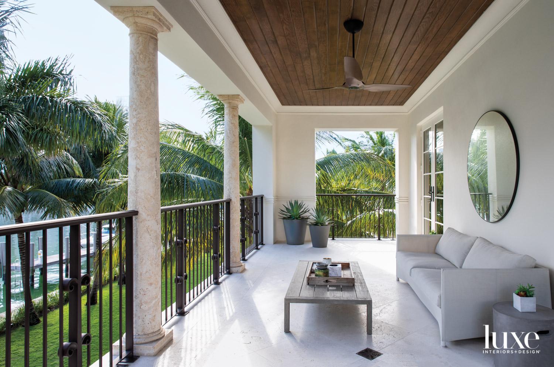 balcony with sofa, coffee table,...