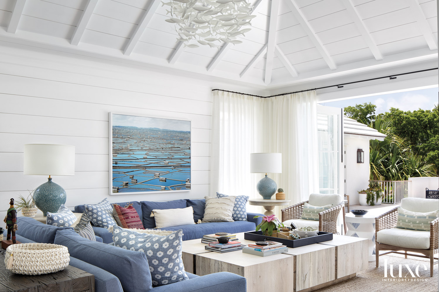 white living area with shiplap,...