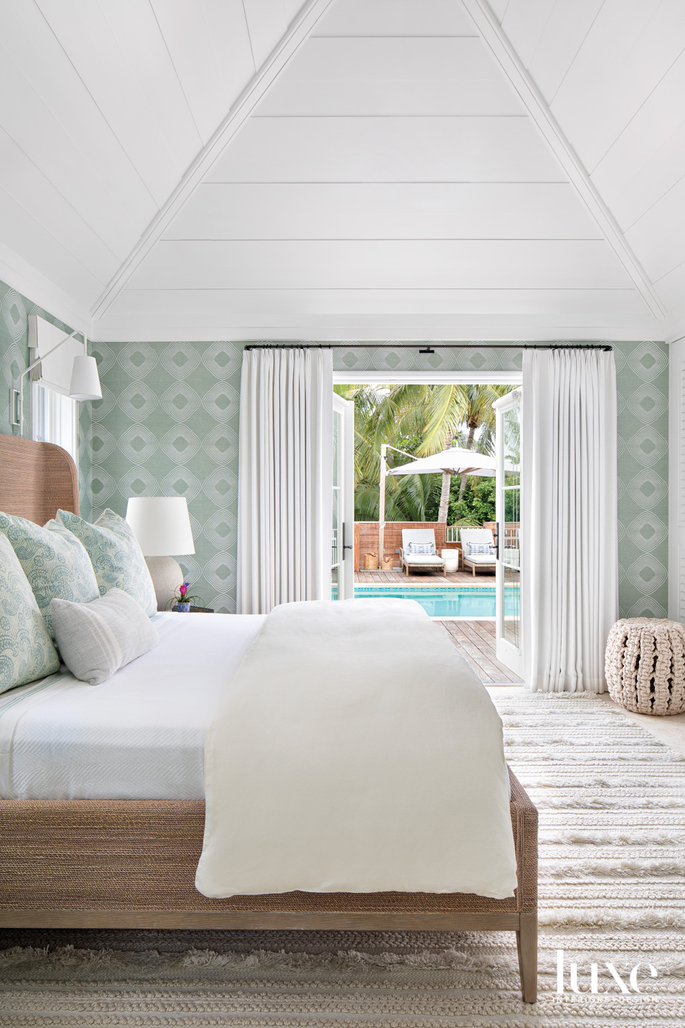 bedroom with green wallcovering, natural...