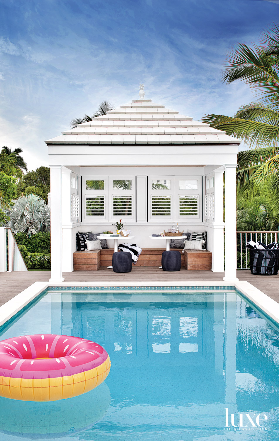 pool deck with white cabana...