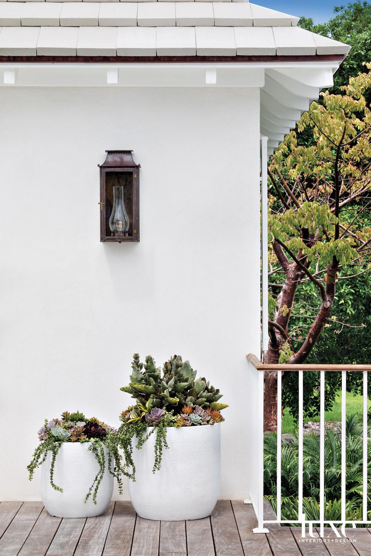 deck with bevolo lantern, planter...