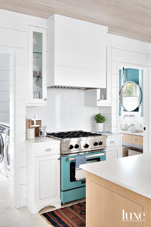 white kitchen with teal range