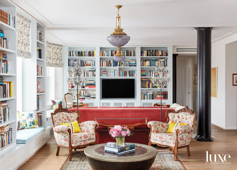 pastel living room with built-in bookshelves