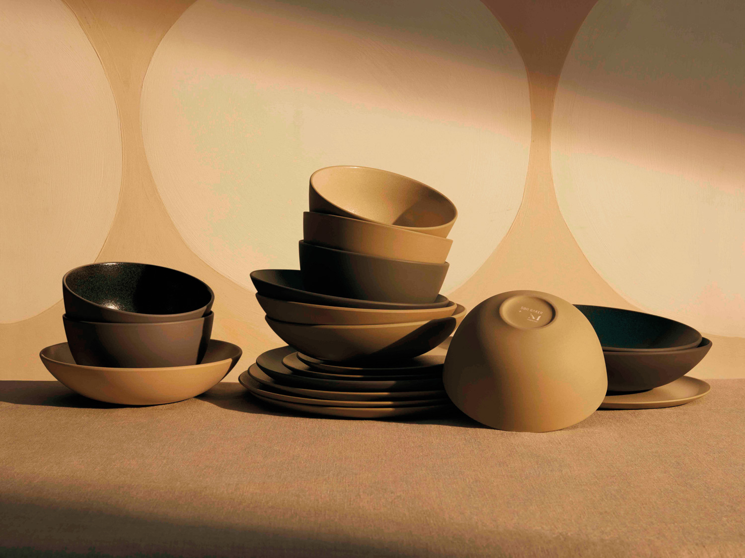Ceramic bowls and plates in earthenware tones