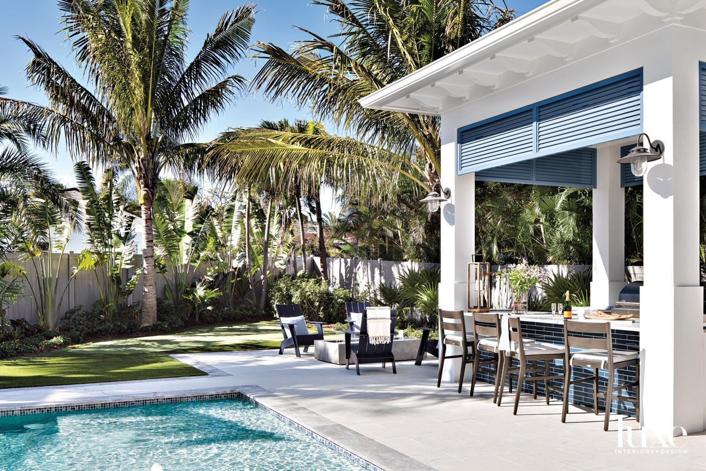 tropical backyard with pool and...