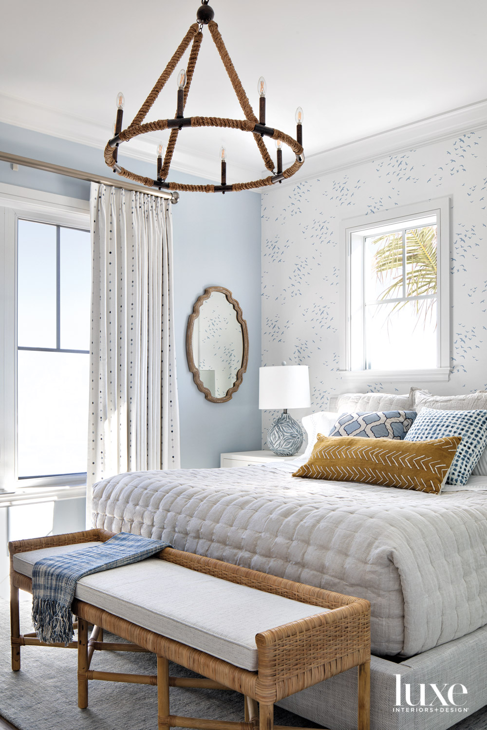 bedroom with white and blue...