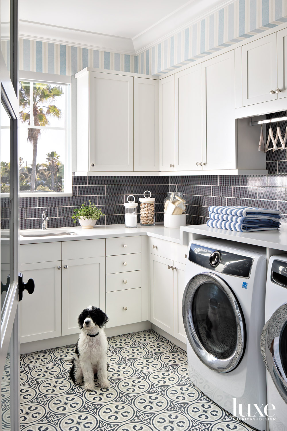 laundry room with patterned floor,...