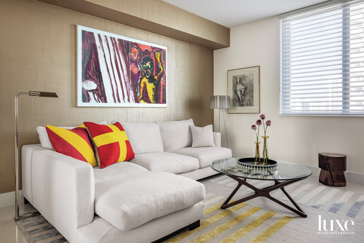family room with white sectional,...