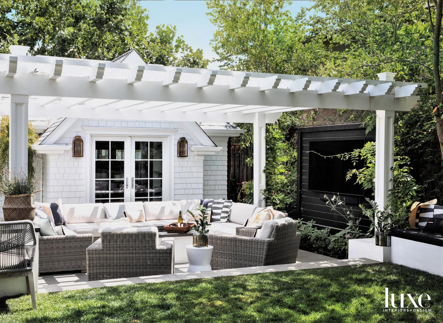 An outdoor seating area has...