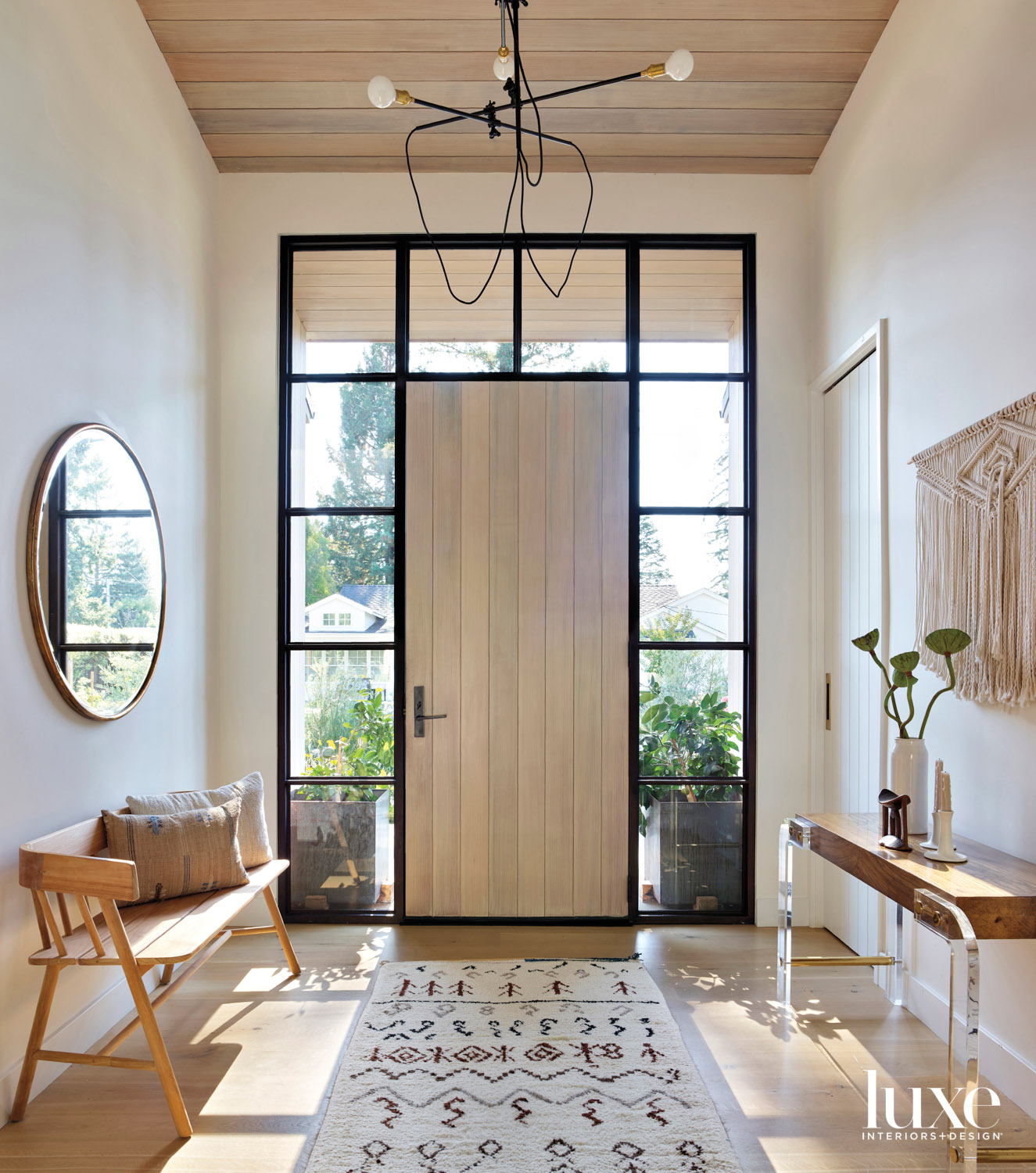 minimalist entry with front door and windows