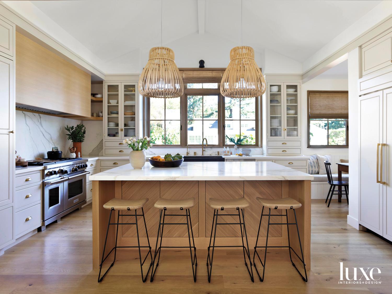 wood kitchen with statement light...