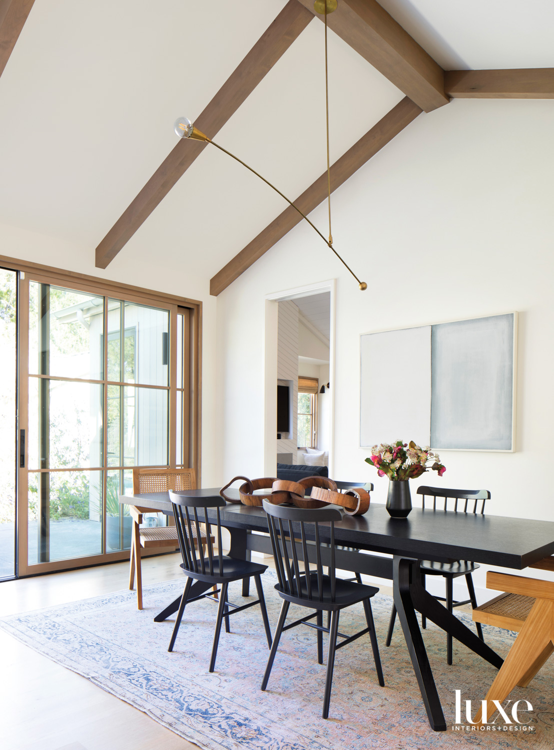 dining room with black table...