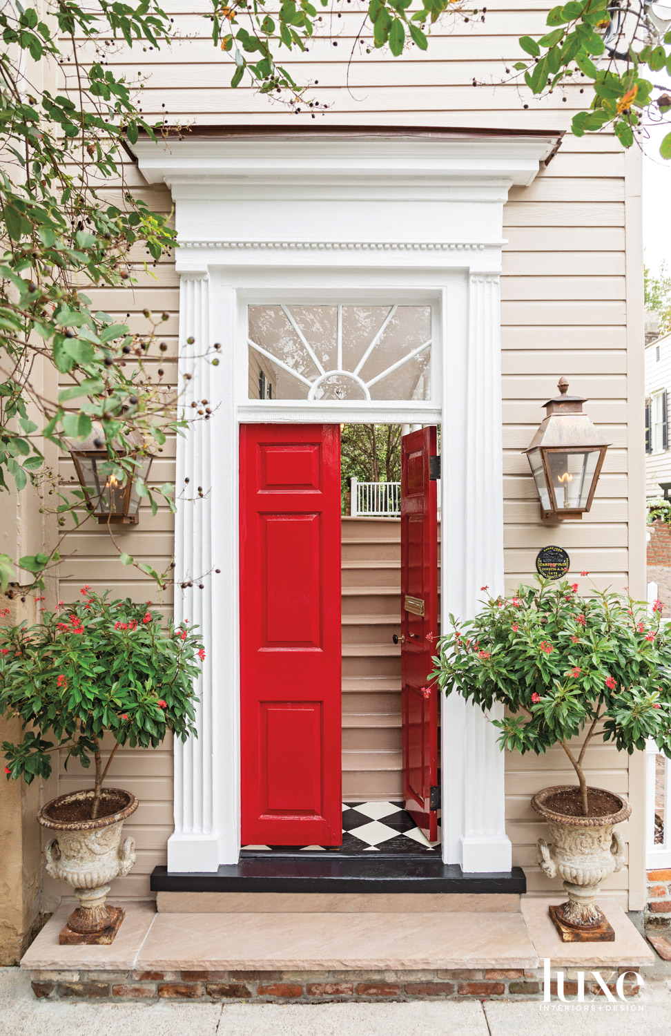 Tan-colored house with red doors