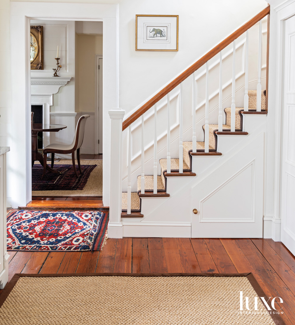 Entryway with wood floors, Persian...