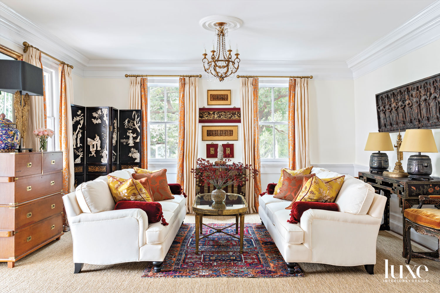 Living room with cream-colored sofas,...