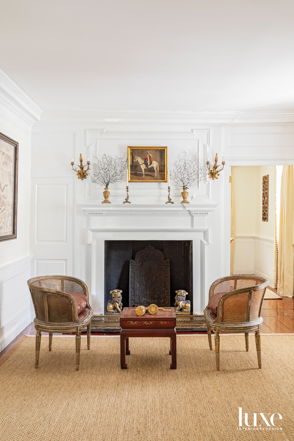 Fireplace with framed oil painting,...