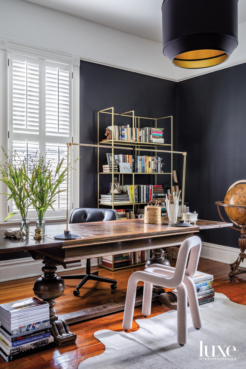 Home office with charcoal walls,...