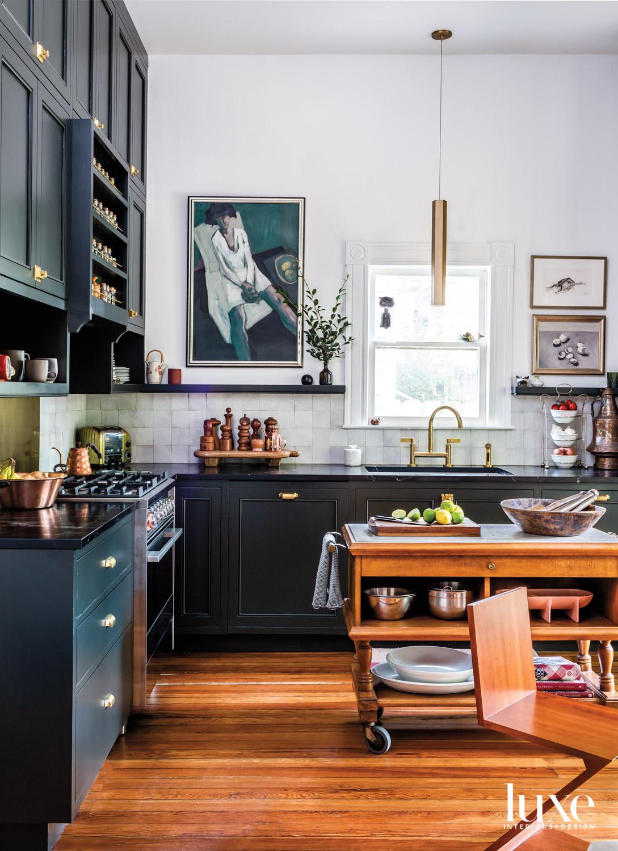 Kitchen with dark teal cabinets,...