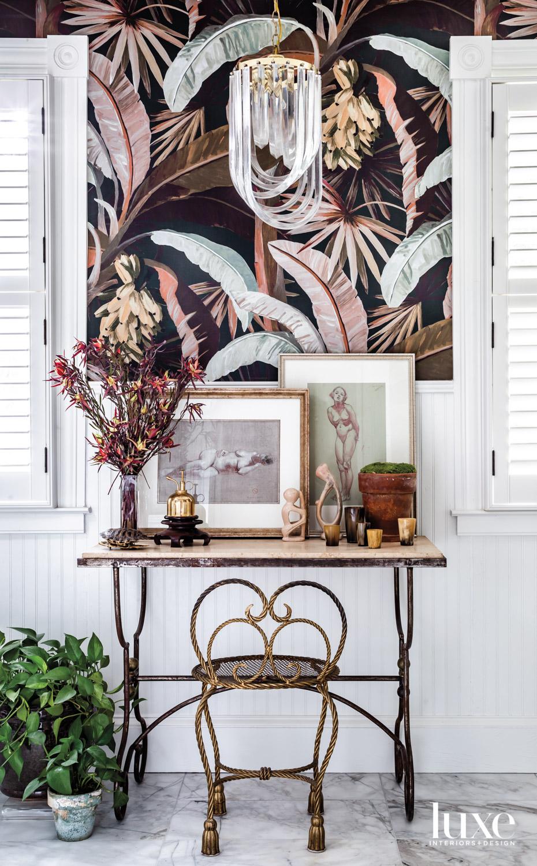 Bathroom vignette with tropical wallpaper...