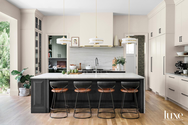 Modern kitchen with cream walls...