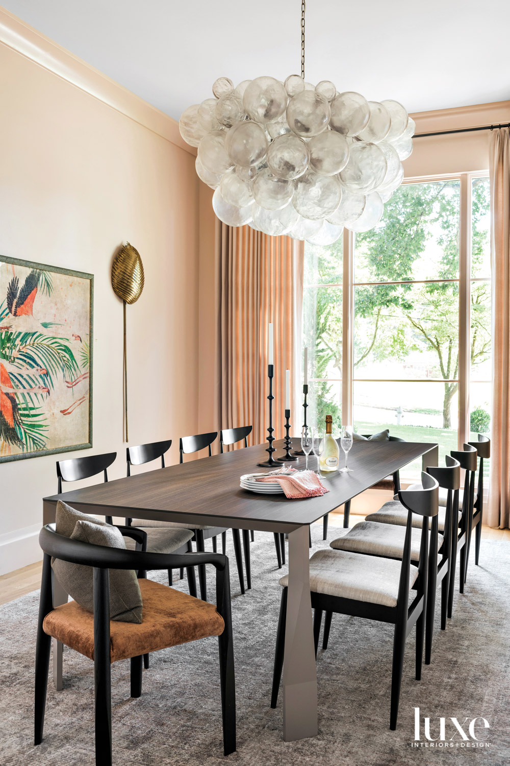 Peach-colored dining room with dark...