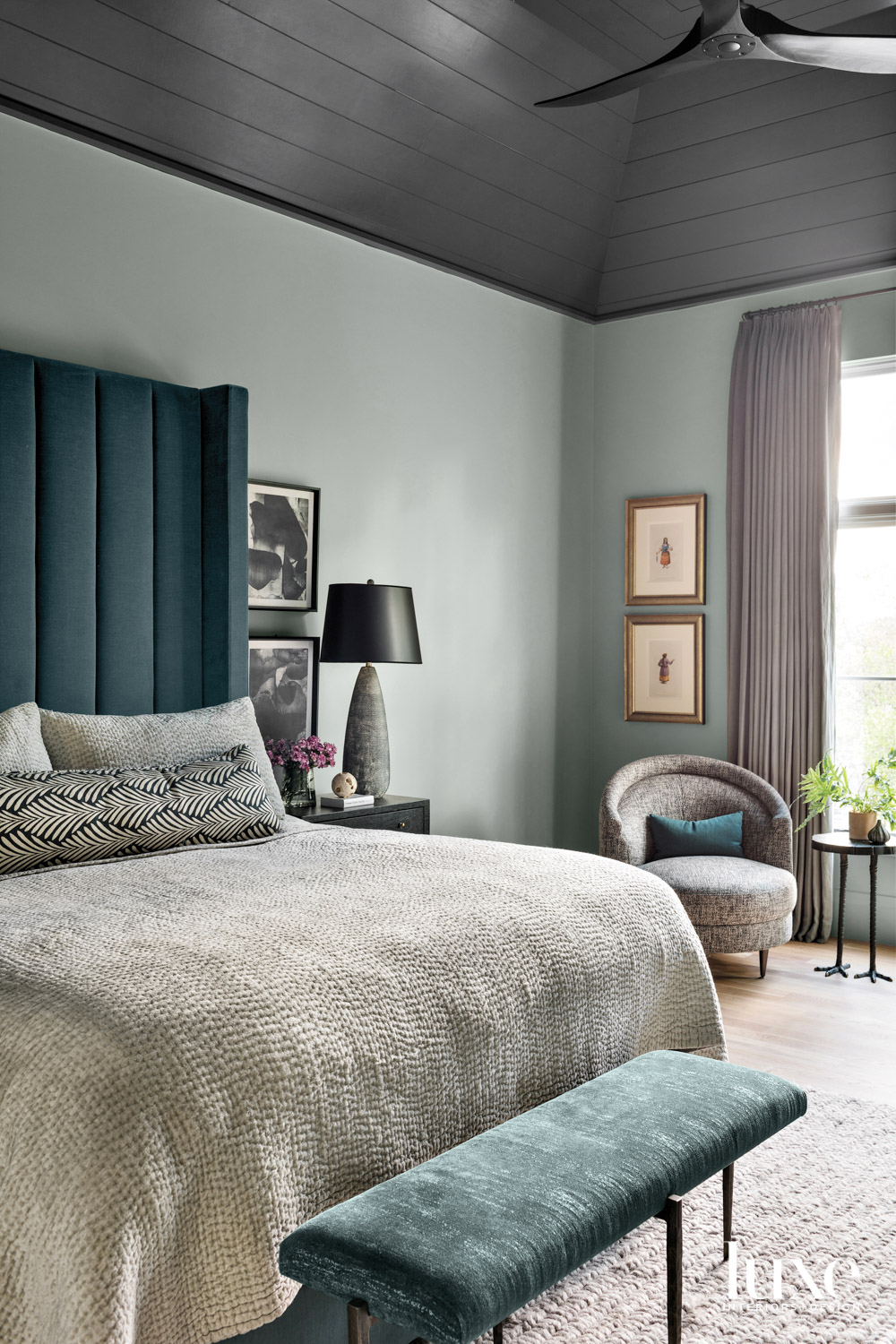Bedroom with sage-colored walls and...