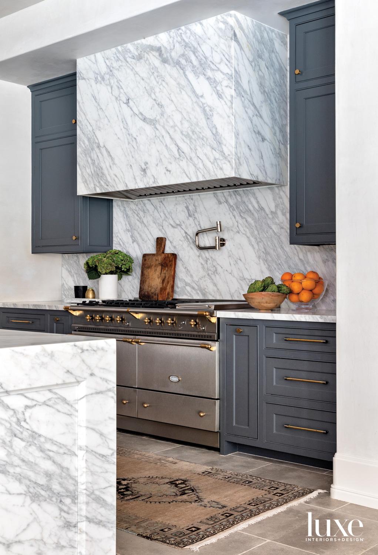 Kitchen featuring Calacatta marble vent...