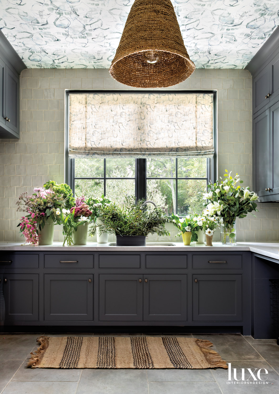 Laundry room with wallpapered ceiling...