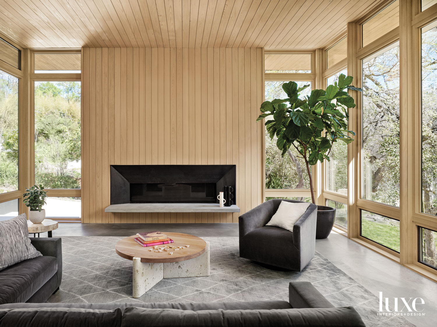 Living room featuring whitewashed-cypress fireplace...