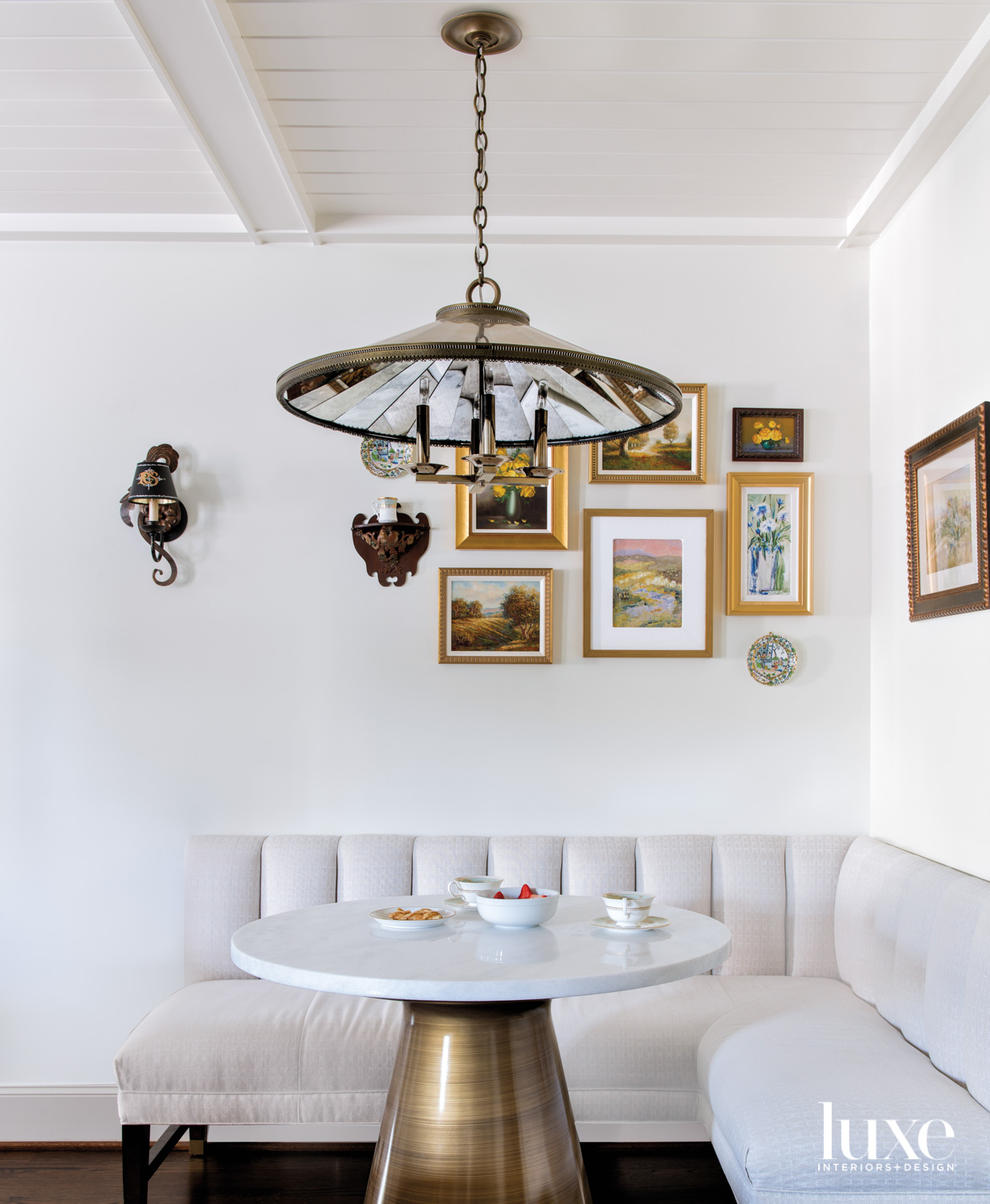 Banquette featuring a table on...