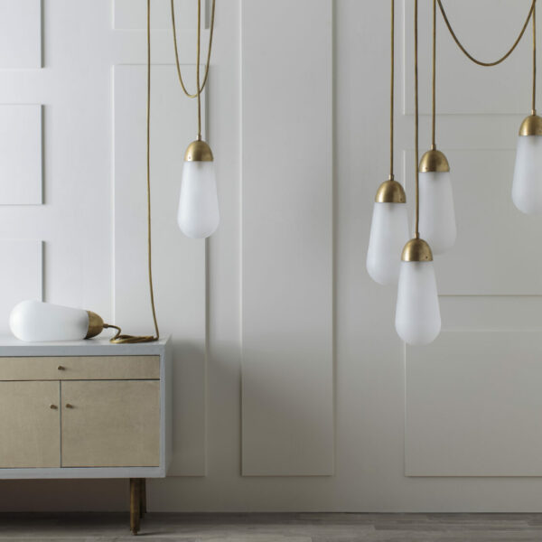12 Lighting Fixtures That Will Spark A Love For Black + Brass