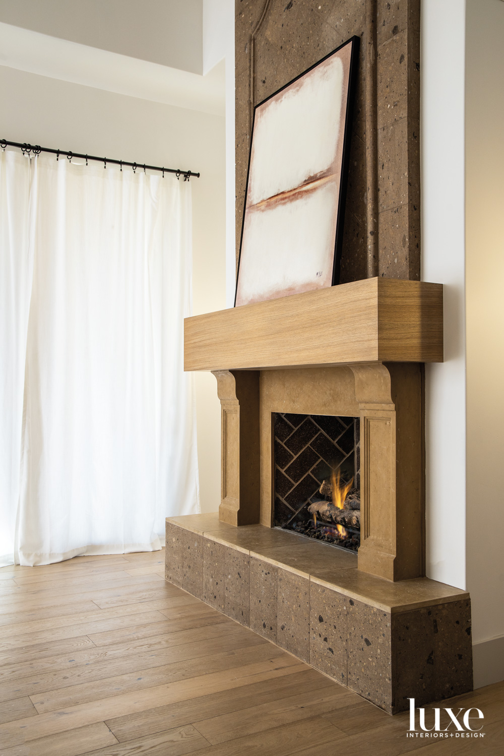 A stone fireplace with a...