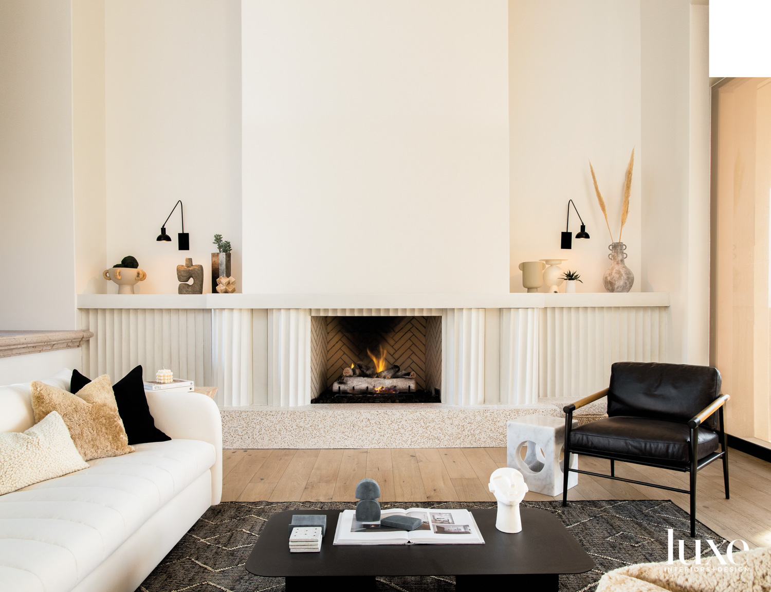 A concrete fireplace with a...
