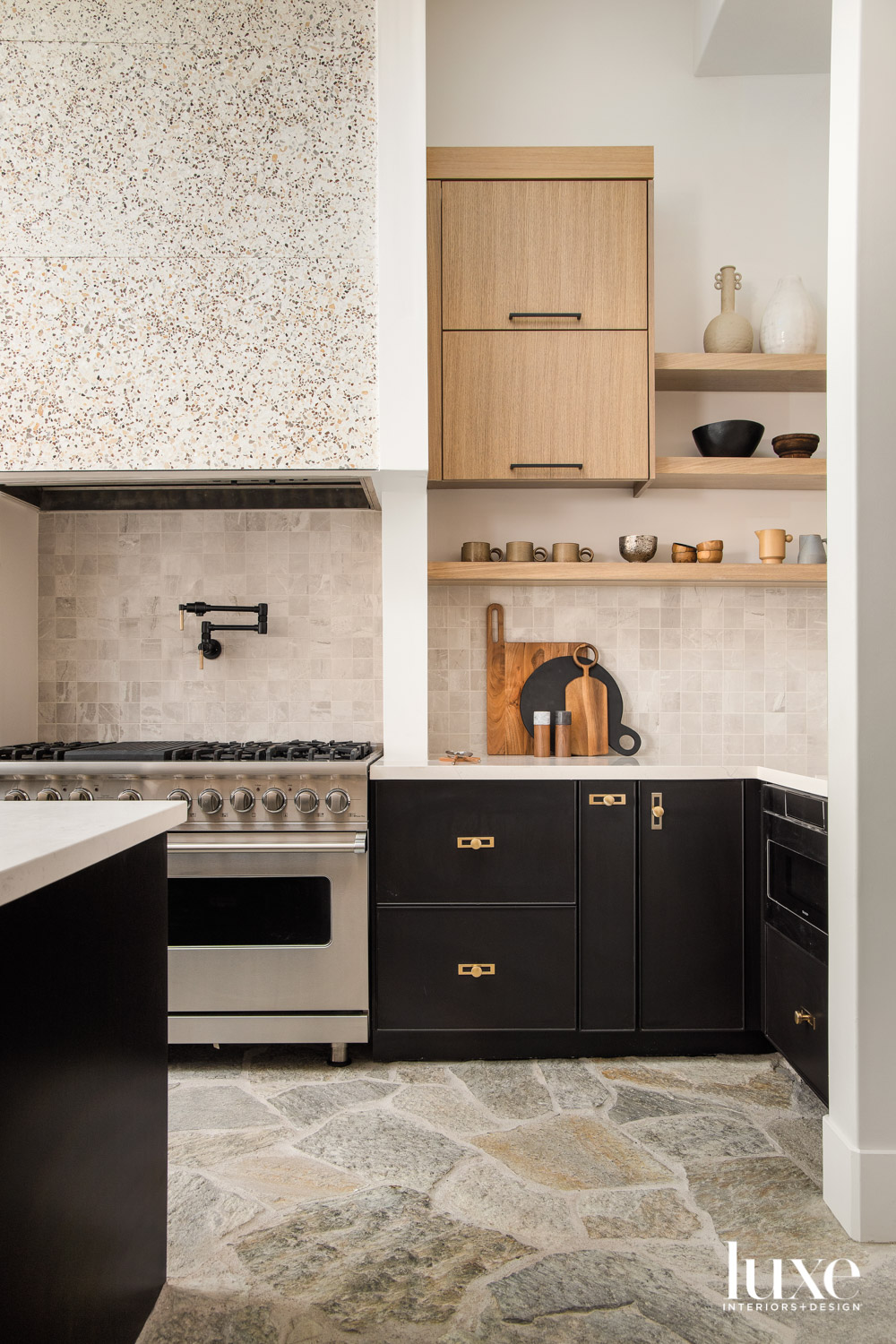 A kitchen with flagstone floors,...