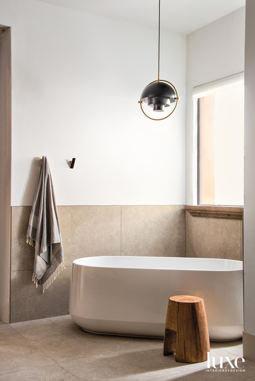 A bathroom with porcelain flooring...
