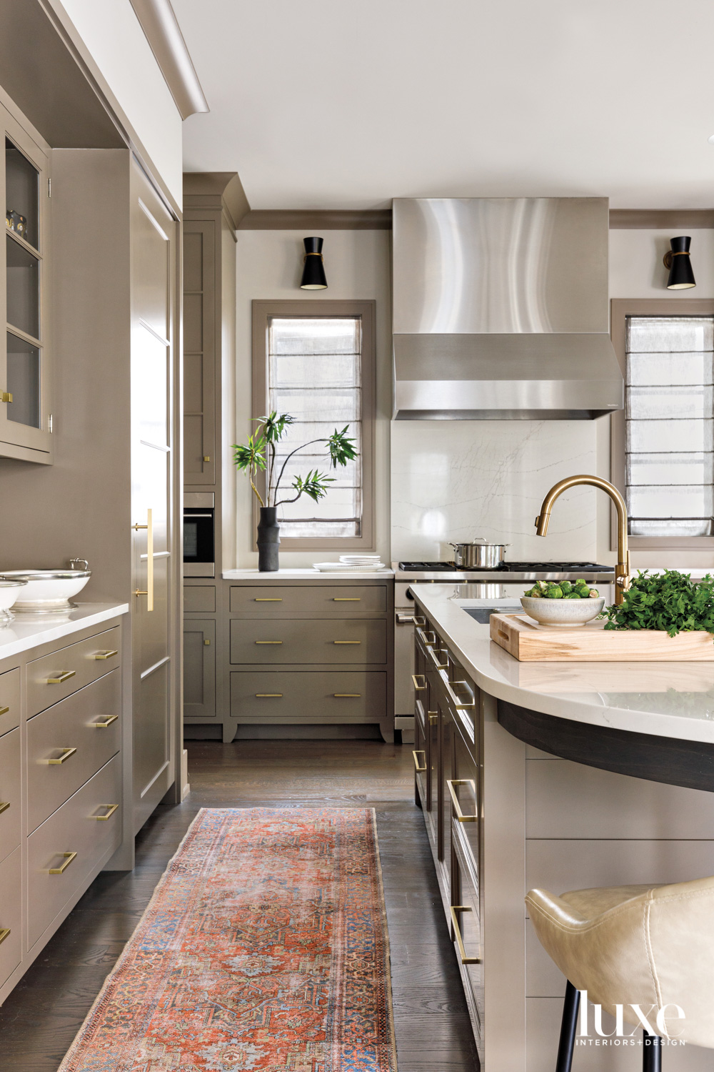 A kitchen with taupe cabinetry...