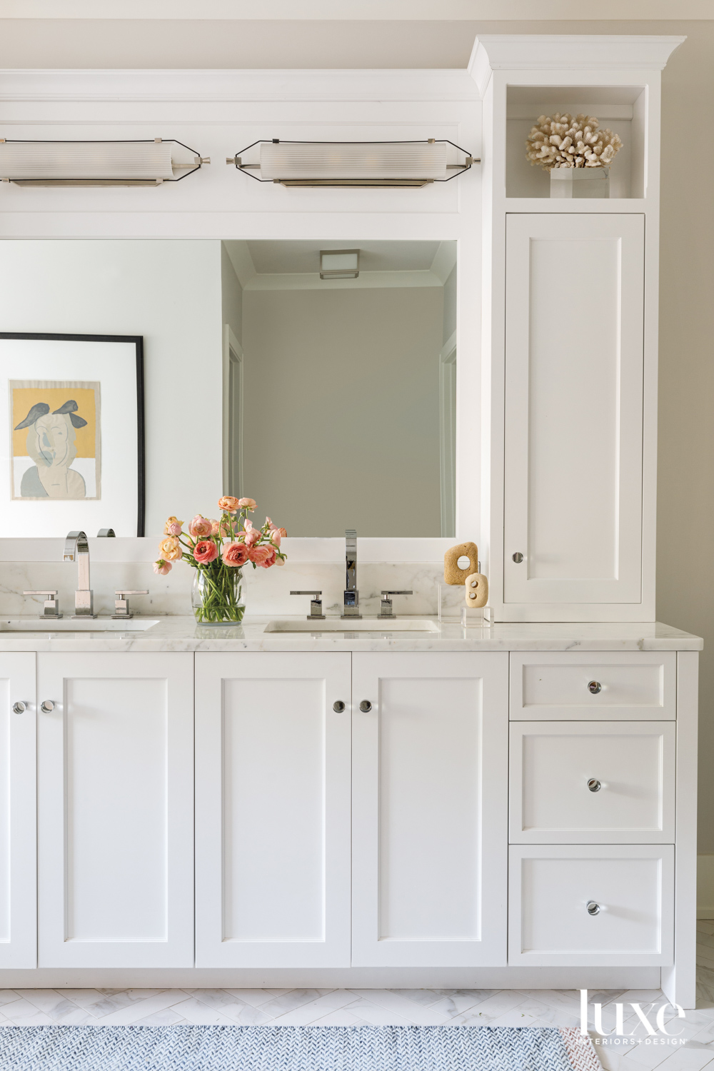 A bathroom with all-white cabinetry...