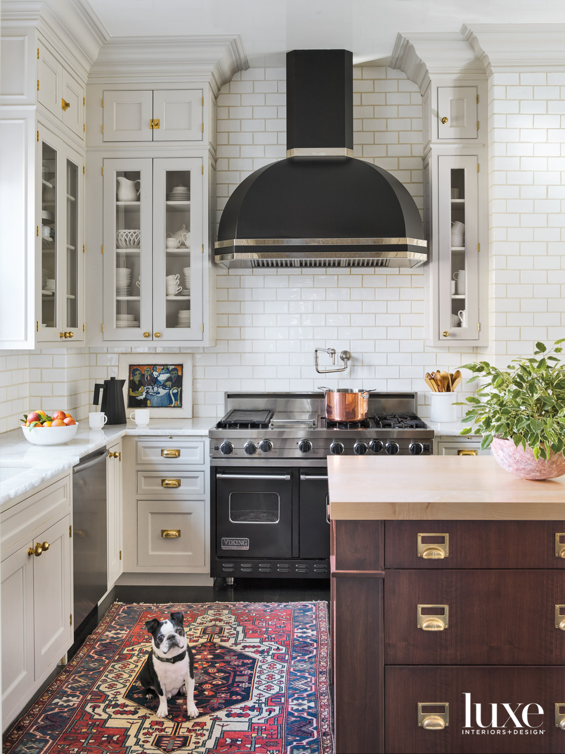 A kitchen with a butcher-block-topped...