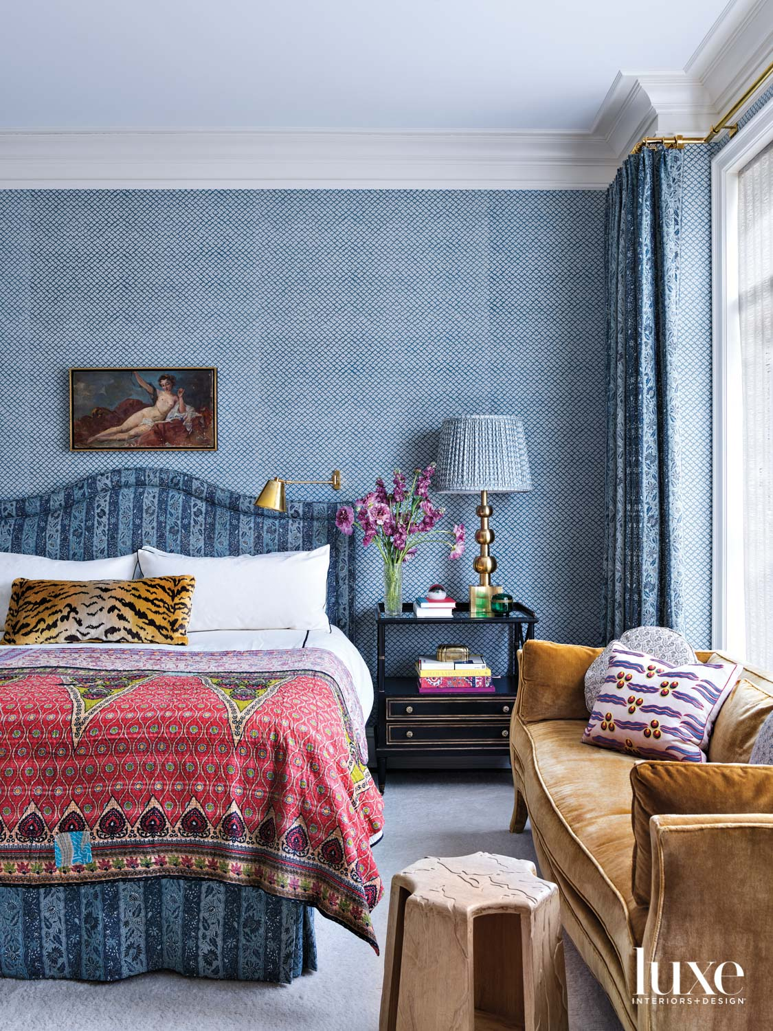 A bedroom with blue patterned...